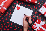 Hand writing a greeting card or love message isolated over grung