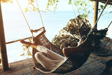 Fototapety Woman relaxing in hommack on the beach