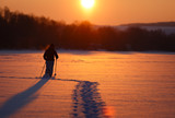 Tourist walking on snow-covered surface of the frozen river. In