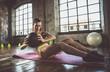 Leinwandbild Motiv Woman training with functional gymnastic in the gym