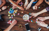 Top view creative photo of friends sitting at wooden table.  having fun while playing board game - 135441017