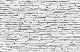 Texture of white and grey stone wall