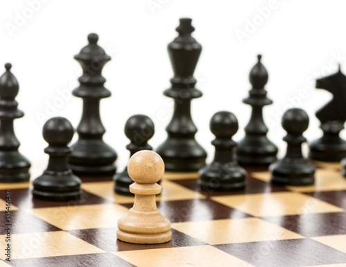 Poster White pawn against a superiority of black chess pieces