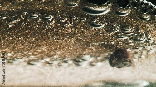 Keuken foto achterwand Paardebloemen en water Oil and seed mixed in a glass, MACRO