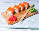 close up of sushi rolls on white tray