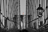 Black and white Brooklyn bridge close up colorful American flag