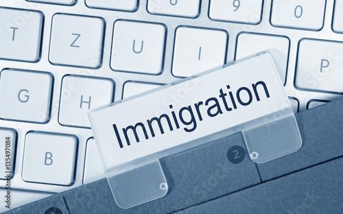 Immigration Folder on Computer Keyboard