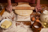 Senior woman hands rolling out dough  flour with rolling pin,hom
