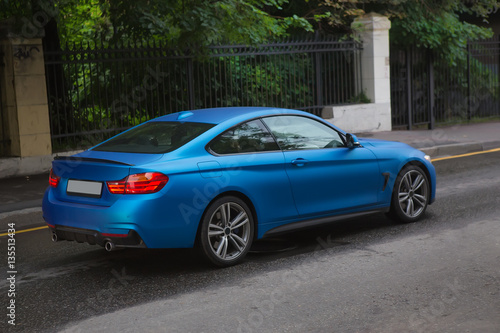 Plagát sports car goes on street