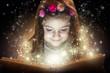 Little girl reading magic book, fantasy concept
