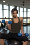 Attractive woman exercising in gym
