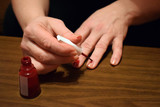 Manicure - Beautiful manicured womans nails with red nail polish