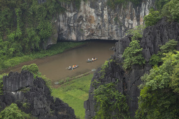 Boats carrying tourist on Ngo Dong river in Tam Coc Bich Dong in Ninh Binh, Vietnam.
