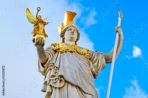 Statue of Pallas Athena in golden helmet near Parliament , Vienna, Austria