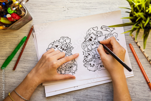 The process of drawing doodles with a pen Poster