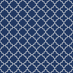 Traditional quatrefoil lattice pattern outline. Navy blue quatrefoil background. Vector illustration.