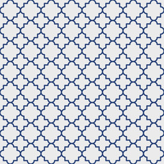 Traditional quatrefoil lattice pattern outline, blue on gray