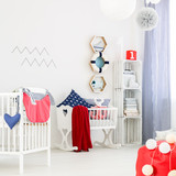 Unisex nursery with wooden cradle
