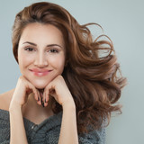 Pretty Woman Smiling. Model with Curly Hair