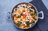 Soup with beans, kale, top view. Typical tuscan soup, ribollita.
