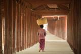 Burmese women bearing the basket