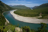 Top view of the beautiful river in the mountains. River Omulevka. Magadan Region. Russia.
