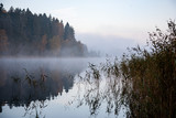 misty countryside landscape with lake in latvia