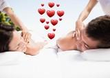 Couple receiving spa massage