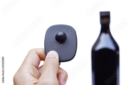 RFID hard tag isolated - Shoplifting and anti-theft system - Electronic Article Surveillance system used with high-value goods - Alcoholic drinks