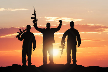 Silhouette Of Soldiers With Rifles