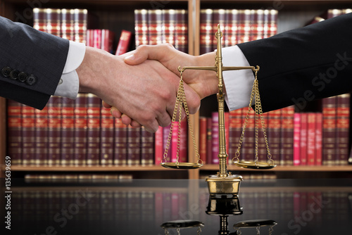 Justice Scale With Judge And Client Shaking Hands