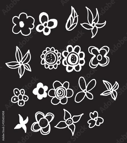 Set of flower doodles on blackboard eps10