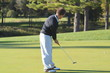A golfer sinks a long putt for birdie and you can see the ball going right in the center of the hole