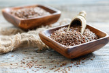Flax seeds in a square wooden bowl. - 135666877