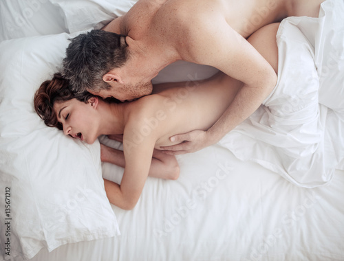 Poster Couple in love having intimate sex in bed