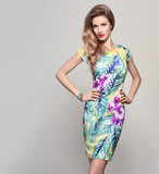 Fashion woman in Trendy Spring Summer Dress. Stylish wavy hairstyle, fashion Makeup, Summer Floral Outfit. Glamour Blond lady in Sexy Bodycon, fashion pose. Playful Girl, Luxury summer Accessories - 135673852