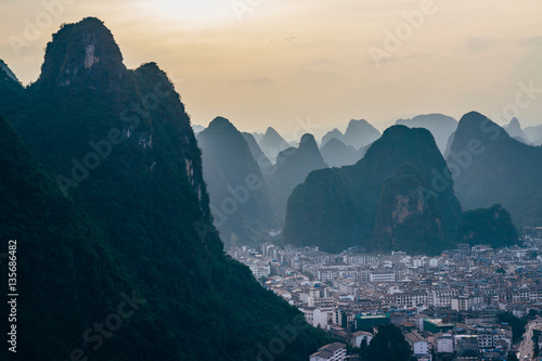 Staande foto Guilin The view at the dawn of the cityscape and karst rock mountains in Yangshuo, Guilin region, Guangxi Province, China.