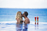 Honeymoon romantic lovers vacation on a tropical beach. Young happy lovers on romantic travel honeymoon having fun on vacation summer holidays romance. - 135686665