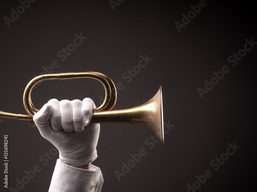 Poster Hand with an old trumpet