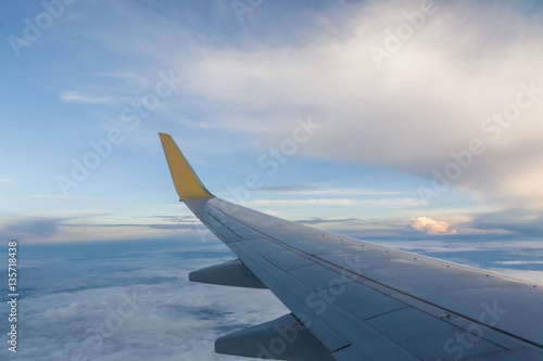 Looking at the wings during flight on airspace of Thailand. - 135718438