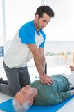 Paramedic performing resuscitation on patient