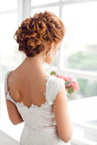 Beautiful bride with fashion wedding hairstyle - 135735608