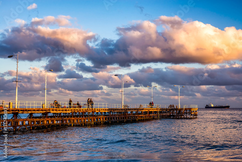 Foto op Canvas Unidentified people walking the pier on a winter day. Limassol, Cyprus