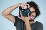 Photographer with digital camera in studio - 135826674