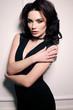 gorgeous sexy woman with dark hair in elegant dress
