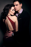 fashion studio photo of lovely impassioned couple in elegant out - 135836094