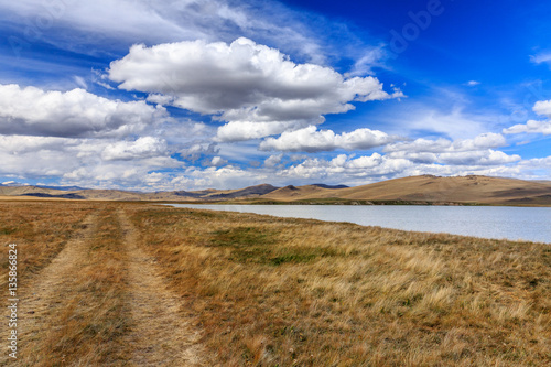 Poster Beautiful steppe mountain landscape with river and clouds. Altai