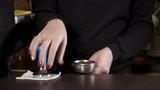closeup of young woman pressing groud cofee
