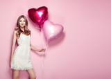Beautiful young woman with heart shape air balloon on color background. Woman on Valentine