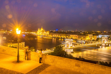 The picturesque view of of the Parliament and the bridge over th